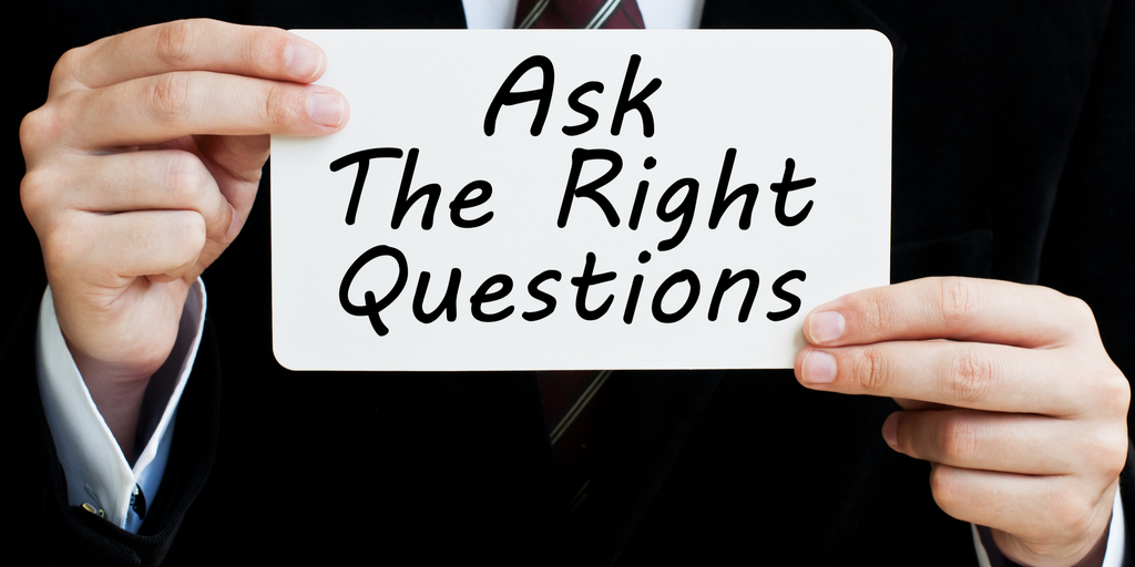 businessman-holding-sign-ask-the-right-questions